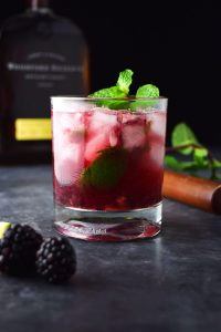 blackberry bourbon smash cocktail with pebble ice