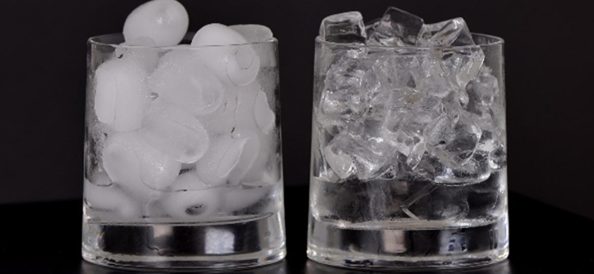 a glass of cloudy ice next to a glass of clear ice