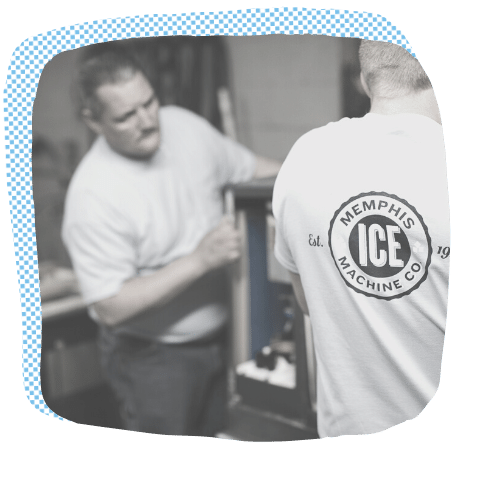 Memphis Ice Company employees repairing an ice machine