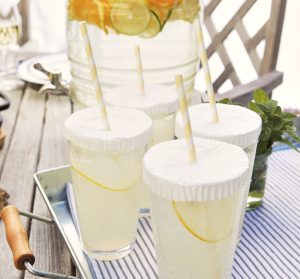 cupcake liners over cups to keep bugs out