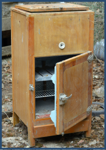 Old Wooden Icebox abandoned in the woods
